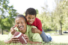 Grandfather And Grandson In Park With Football Stock Images