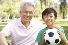 Grandfather And grandson In Park With Football Stock Photos