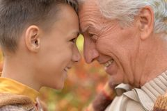 Grandfather and grandson  in park Royalty Free Stock Photography