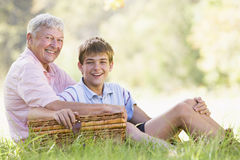 Grandfather and grandson at a picnic smiling Royalty Free Stock Photography