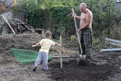 Grandfather with grandson planting seedling Royalty Free Stock Images