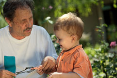 Grandfather and grandson play Stock Photography