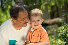 Grandfather and grandson play Stock Photo