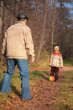 Grandfather and grandson play ball in wood Royalty Free Stock Photography