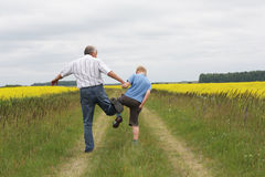 Grandfather and grandson playing Royalty Free Stock Image