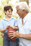 Grandfather And Grandson Playing American Football Royalty Free Stock Photos