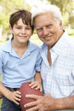Grandfather And Grandson Playing American Football Royalty Free Stock Images