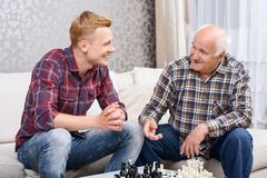 Grandfather and grandson playing chess Royalty Free Stock Images