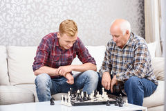 Grandfather and grandson playing chess Royalty Free Stock Photo