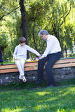 Grandfather and grandson playing chess in a park. On sunny day Royalty Free Stock Photo