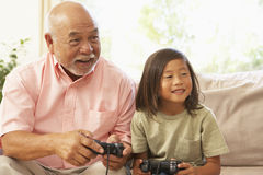 Grandfather And Grandson Playing Computer Game At Stock Images