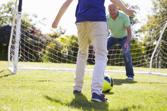Grandfather And Grandson Playing Football Together Royalty Free Stock Photo