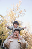 Grandfather and Grandson Playing in the Park Having Fun Stock Photo