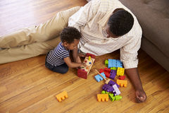Grandfather And Grandson Playing With Toys On Floor At Home Royalty Free Stock Photography
