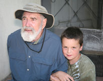 Grandfather with grandson on porch Stock Images