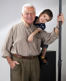 Grandfather and grandson posing royalty free stock photos