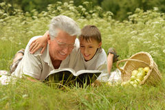 Grandfather and  grandson reading book Royalty Free Stock Photos