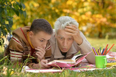 Grandfather and  grandson reading book Stock Photo