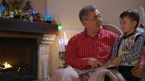 Grandfather and grandson reading a book stock video footage