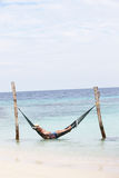 Grandfather And Grandson Relaxing In Beach Hammock Royalty Free Stock Photos