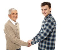 Grandfather and grandson shaking hands Royalty Free Stock Photo