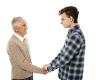 Grandfather and grandson shaking hands Royalty Free Stock Image
