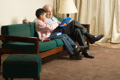 Grandfather and grandson sitting on a couch - Hori Royalty Free Stock Photos