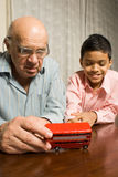 Grandfather and grandson sitting at the table Royalty Free Stock Photography