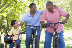 Grandfather grandson and son bike riding Stock Images