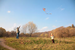 Grandfather and the grandson start kite Stock Photo