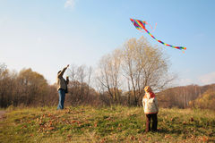 Grandfather and grandson start kite Royalty Free Stock Image