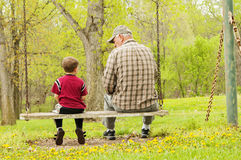 Grandfather grandson together swing Royalty Free Stock Image