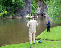 Grandfather and Grandson Trout Fishing Royalty Free Stock Photography