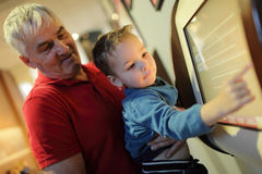 Grandfather and grandson using touch screen Stock Image