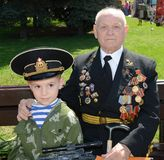 Grandfather and grandson on Victory Day Royalty Free Stock Images