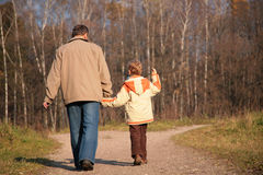 Grandfather and the grandson walk on wood Royalty Free Stock Images