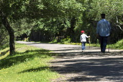 Grandfather and grandson walking Stock Photography