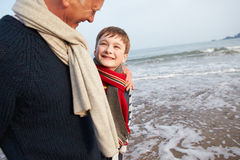 Grandfather And Grandson Walking On Winter Beach Stock Photos