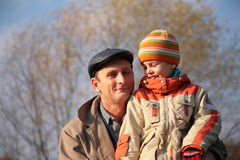 Grandfather and grandson in wood Stock Image