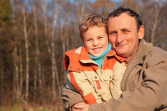 Grandfather and grandson in wood Stock Photo