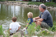 Grandfather and grandsons Stock Photo