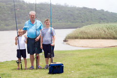 Grandfather grandsons fishing royalty free stock photo