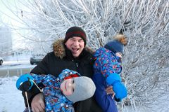 Grandfather with grandsons in winter park stock photography