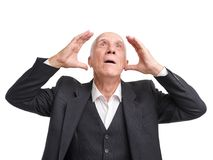 Grandfather greatly surprised and looking upwards on a white isolated background Royalty Free Stock Photo