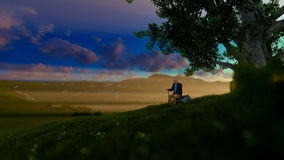 Grandfather on green meadow, resting under a tree, morning sun, tilt stock footage