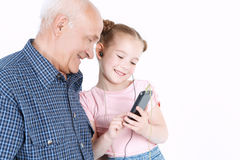 Grandfather having fun with his granddaughter Royalty Free Stock Photos