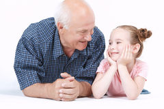 Grandfather having fun with his granddaughter Royalty Free Stock Photo