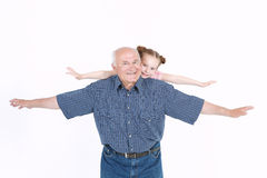 Grandfather having fun with his granddaughter Stock Image