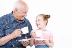 Grandfather having fun with his granddaughter Stock Photography