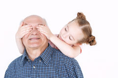 Grandfather having fun with his granddaughter Royalty Free Stock Photography
